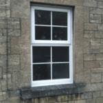 street window of brick building