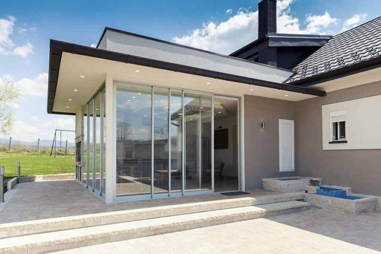 sliding doors on modern conservatory garden room