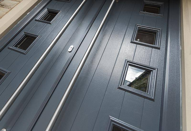 double door handles on modern grey composite door
